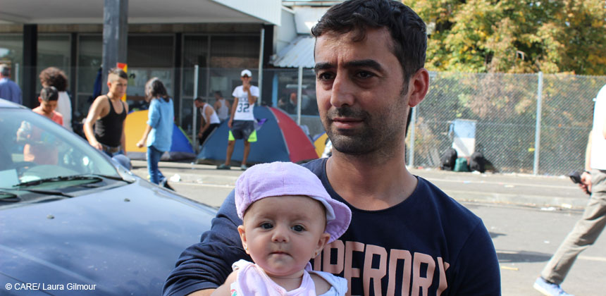 Ahmad with his two month old daughter in Horgos, at the Serbian border with Hungary