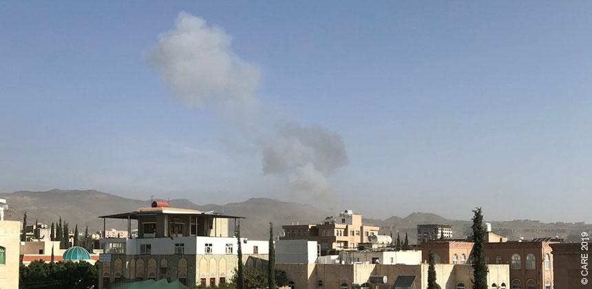 Smoke from bombs over rooftops in Sana'a Yemen