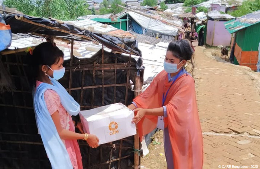 Girls with care package at Cox's Bazar refugee camp