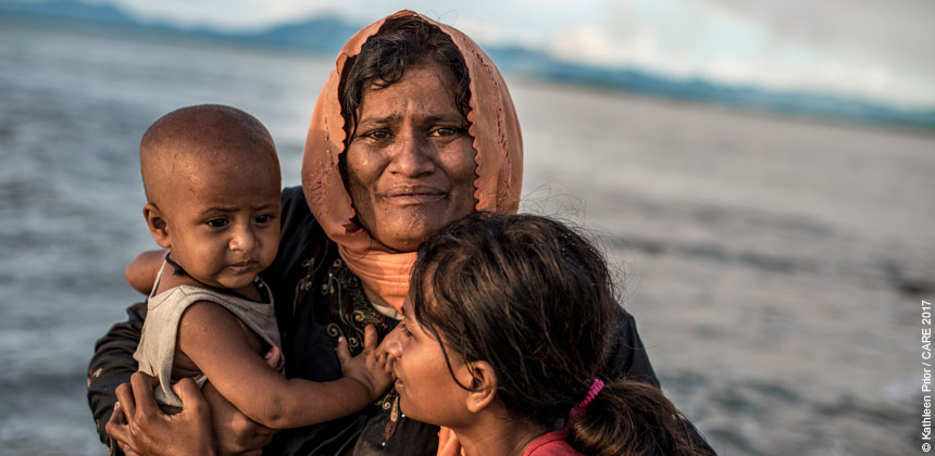 A refugee woman with two children arriving in Bangladesh