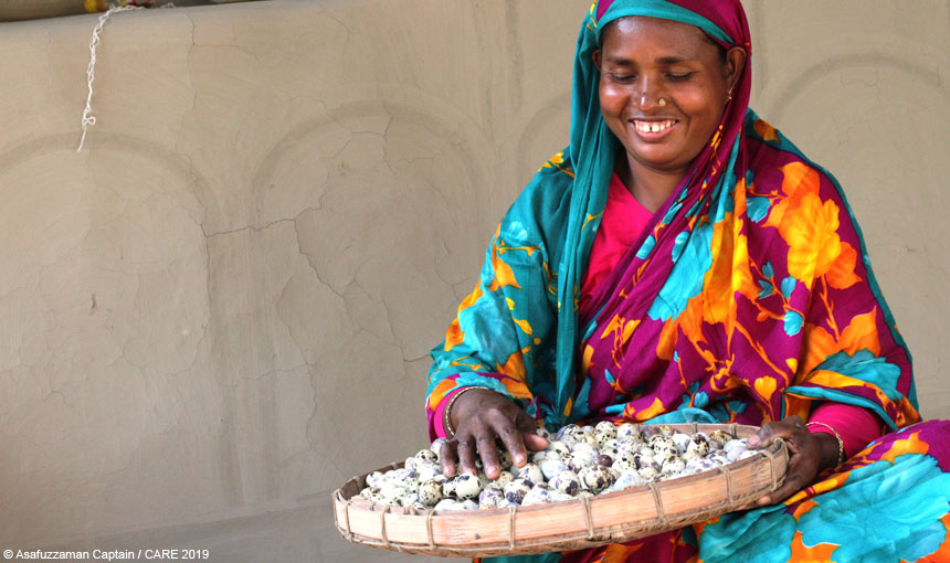 Harisa Begum with a tray of quail eggs