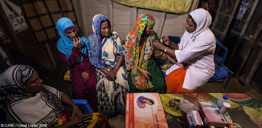 Midwife with women in a home in Bangladesh