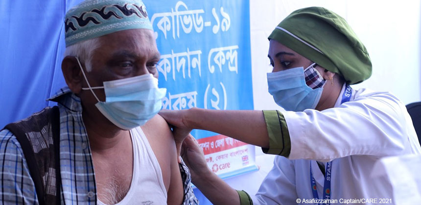 A woman health worker administers a COVID-19 vaccination in Gazipur, Bangladesh