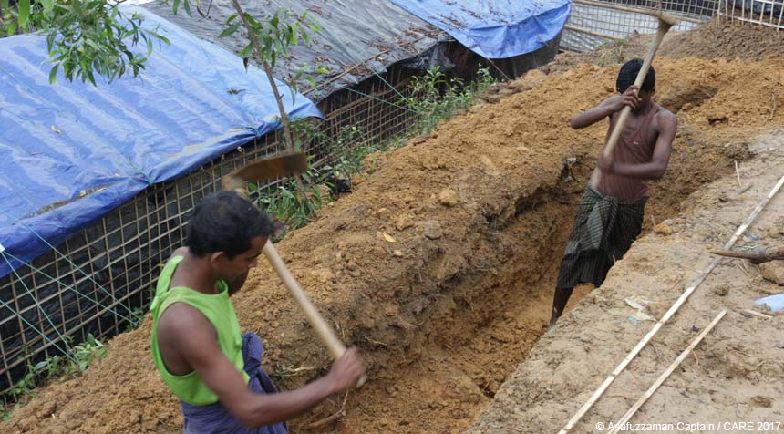 Two men digging a trench at the refugee camp in Bangladesh