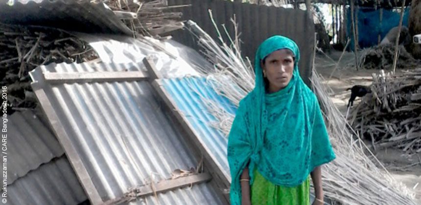 Monoara Begum in her house damaged by floods