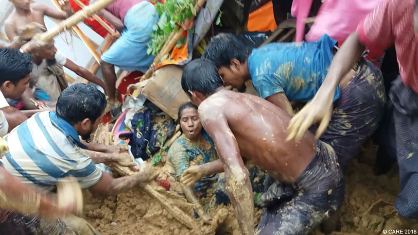 Woman being rescued from mudslide in refugee camp in Bangladesh