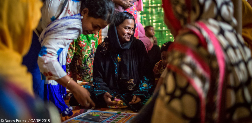 Women playing a board game in a women's centre at refugee camp