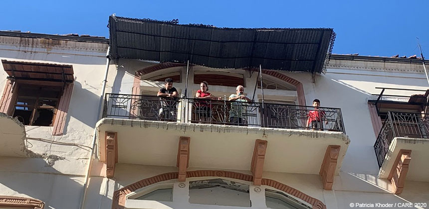 Amira and her family on the balcony of their building