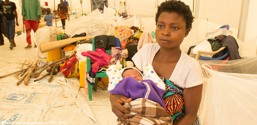 Mother and baby in tent at refugee centre in Burundi