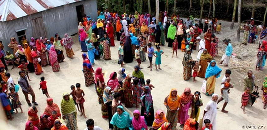 Crowd of people in Bangladesh collecting emergency cash aid
