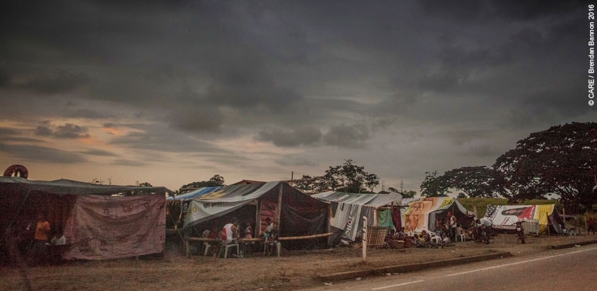 People camping by the roadside
