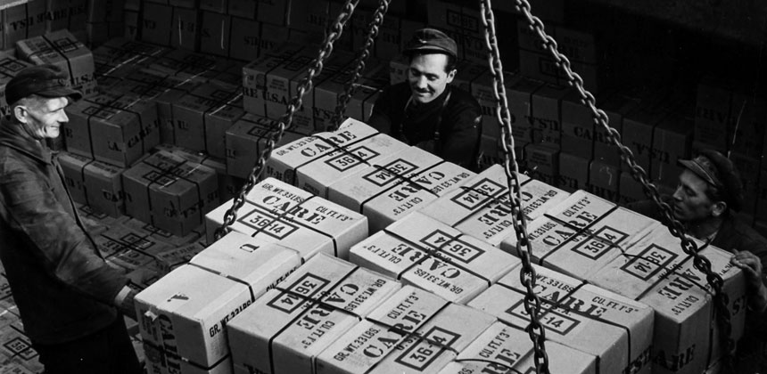CARE packages being unloaded from a ship