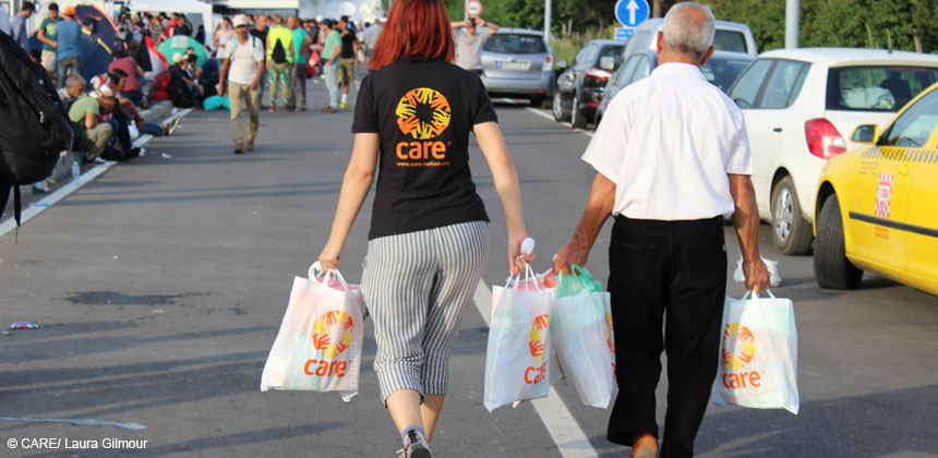 CARE staff distribute baby packages to refugees in Serbia