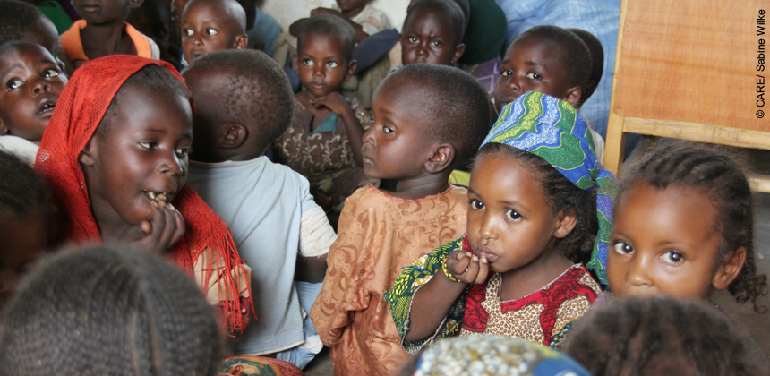 Refugee children from CAR eating together at one of CARE's child-friendly spaces in Dosseye refugee camp, Southern Chad