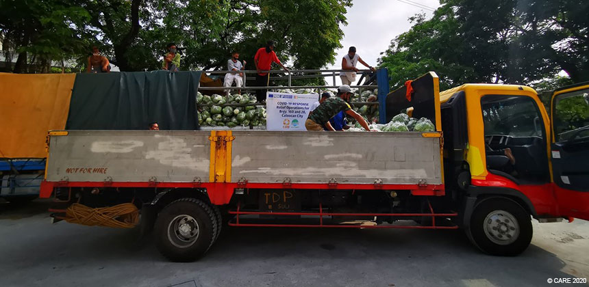 Lorry distributing food packages in the Philippines