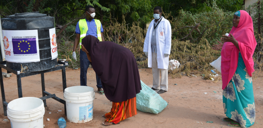 Women collect water as part of CARE's COVID response in Dadaab