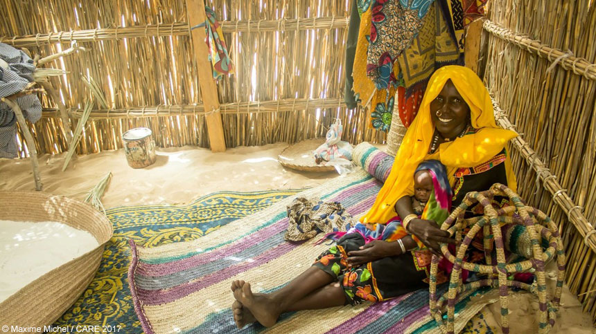 Amina inside her new shelter in Chad