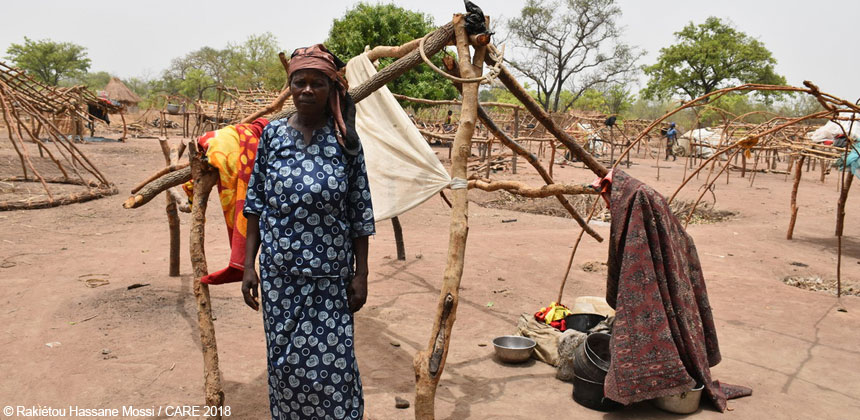 Woman outside makeshift shelter in Chad