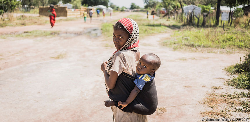 Young girl carrying baby in Chad