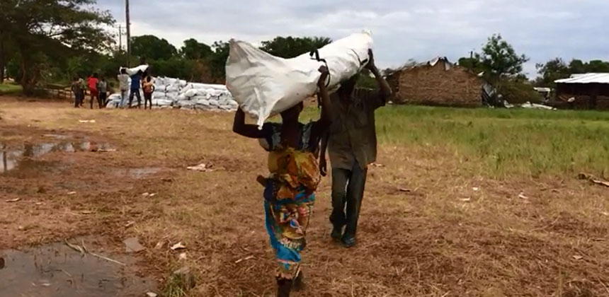 People carrying tent package in Mozambique
