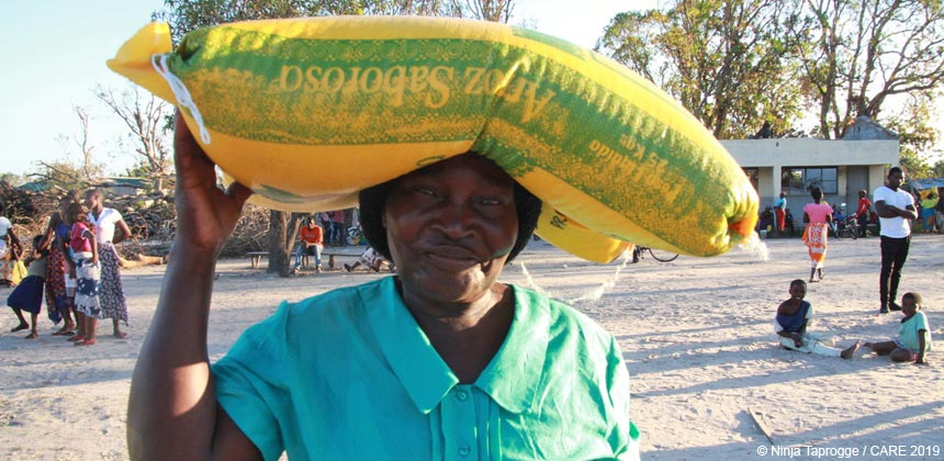 Woman with sack of rice in Mozambique