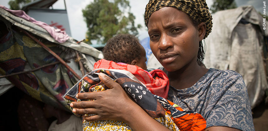 A woman in the Democratice Republic of Congo holding her baby