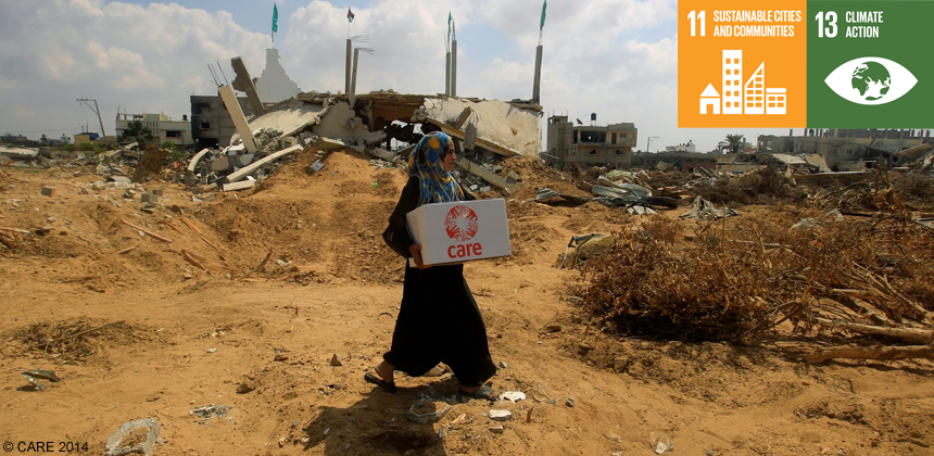 Woman carrying CARE package in Gaza
