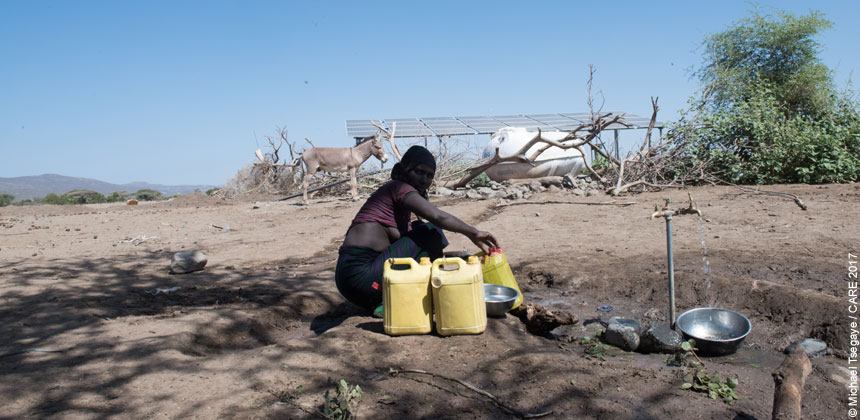 A woman filling jerry cans in Bilu, Ethiopia
