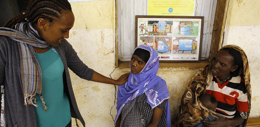 A CARE health worker talking to a pregnant woman