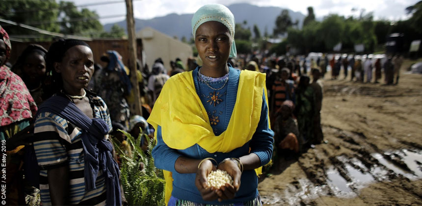 A woman in Ethiopia holding a handful of seeds
