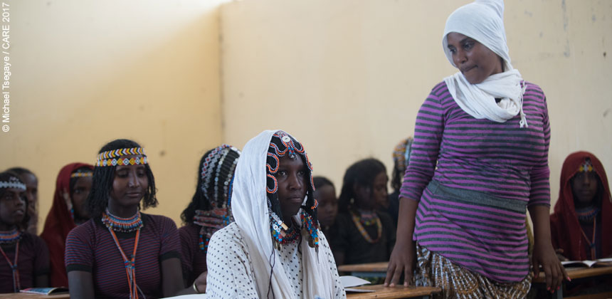 Teacher and female students in classroom in Ethiopia