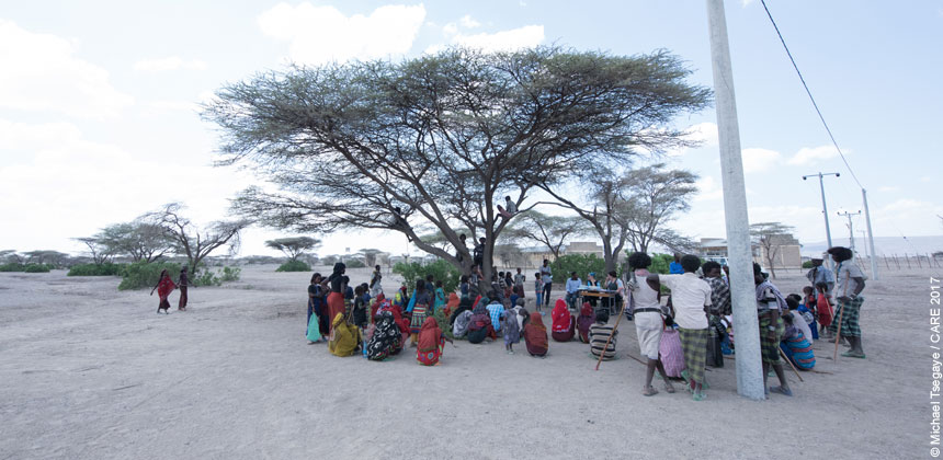 A community meeting under a tree in Ferehenu, Ethiopia