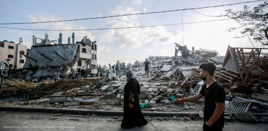 Palestinian woman inspects her destroyed house after an Israeli air strike in Beit Lahia northern Gaza strip.