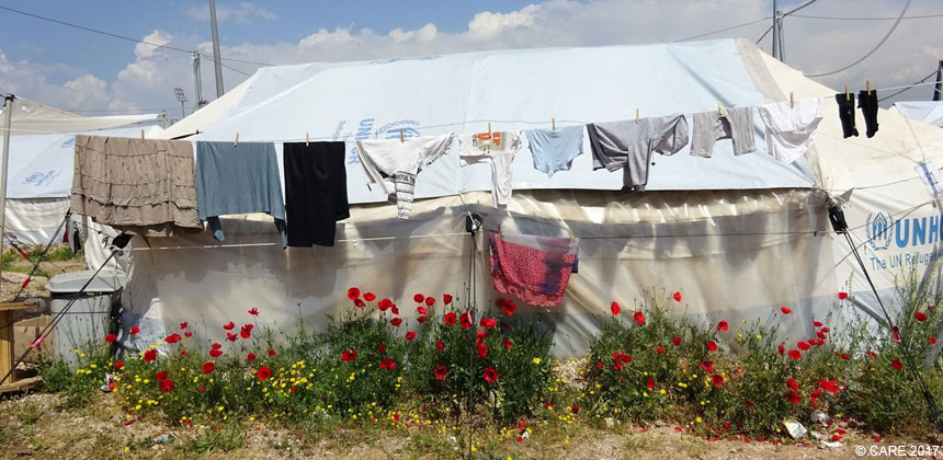 Clothes drying outside a tent at a refugee camp