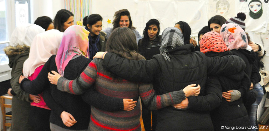 Women in a circle in a group hug