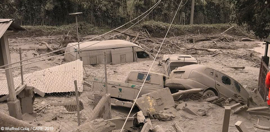Cars and buildings covered in ash after volcano eruption