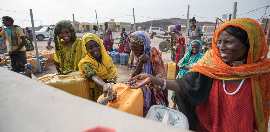 Women and girls at a water collection point in Ethiopia