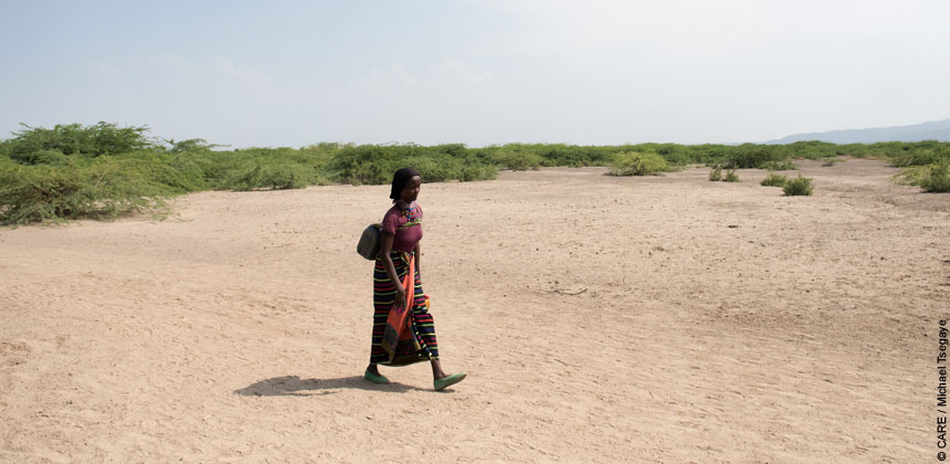 Woman walking in the arid landscape in Ethiopia