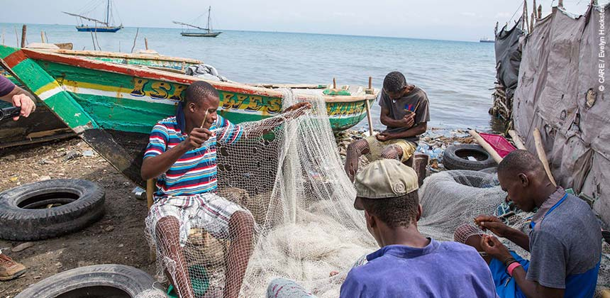 Fishermen repair their nets