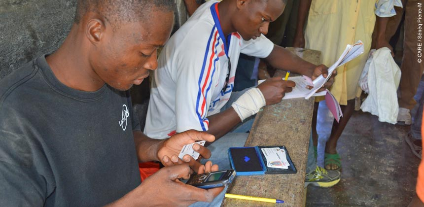 Two men check funds using mobile phones