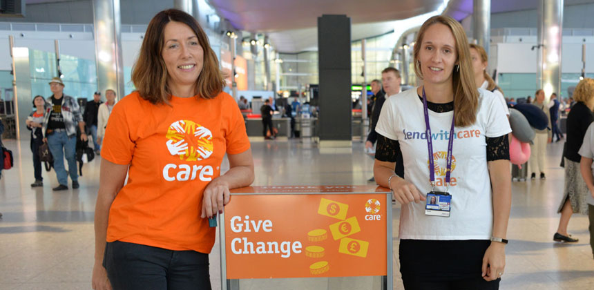 CARE and Heathrow staff beside a collection box at Heathrow airport