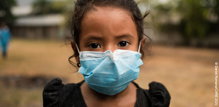 A young girl in Honduras, wearing a face mask