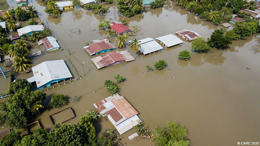 Aerial photo of house roofs in flooded village