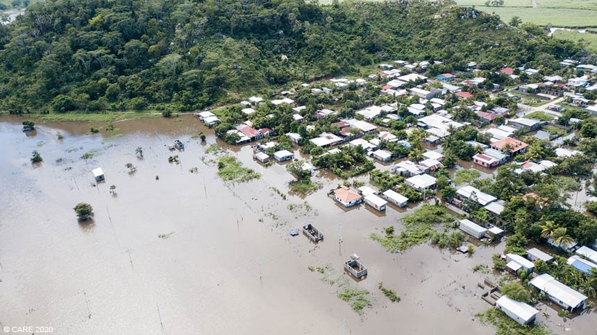Village houses and fields covered in flood waters