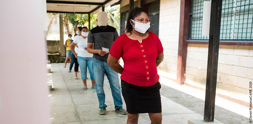 People in masks queuing in Honduras