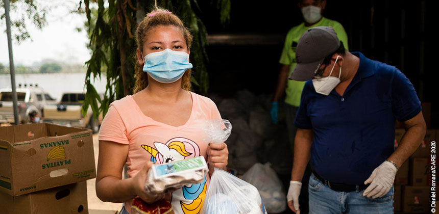 People wearing masks at a food distribution in Honduras