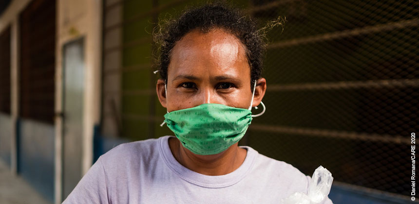 Woman wearing green face mask