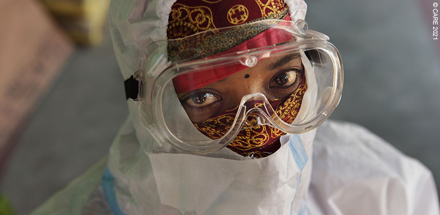 A woman in Bihar, India, wearing a mask and PPE