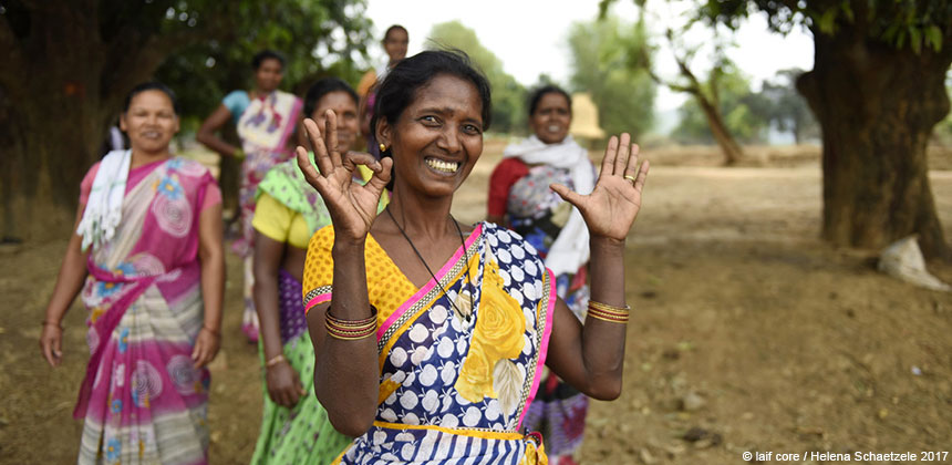Dilmani Kujur, a farmer in India, with women from her community