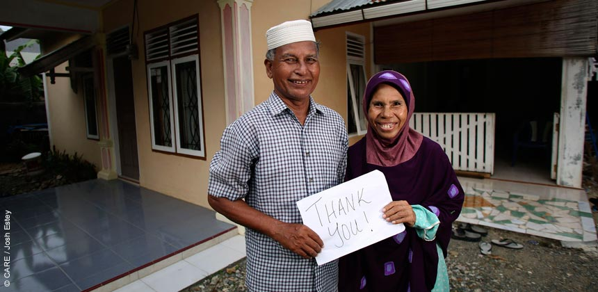 Mariana Abdullah and her husband outside their home